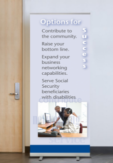 Banner featuring two employees working in a call center. One is blind and is using assistive technology.