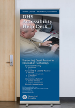 Display banner featuring a DHS employee who is blind using assistive technology and a listing of the help desk's services