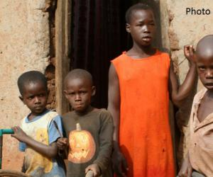 Four boys and a girl outside an building in Africa